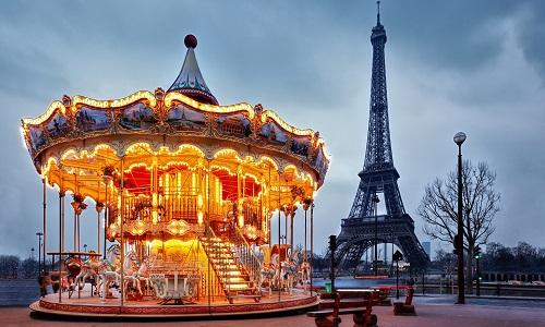 illuminated vintage carousel close to Eiffel Tower, Paris